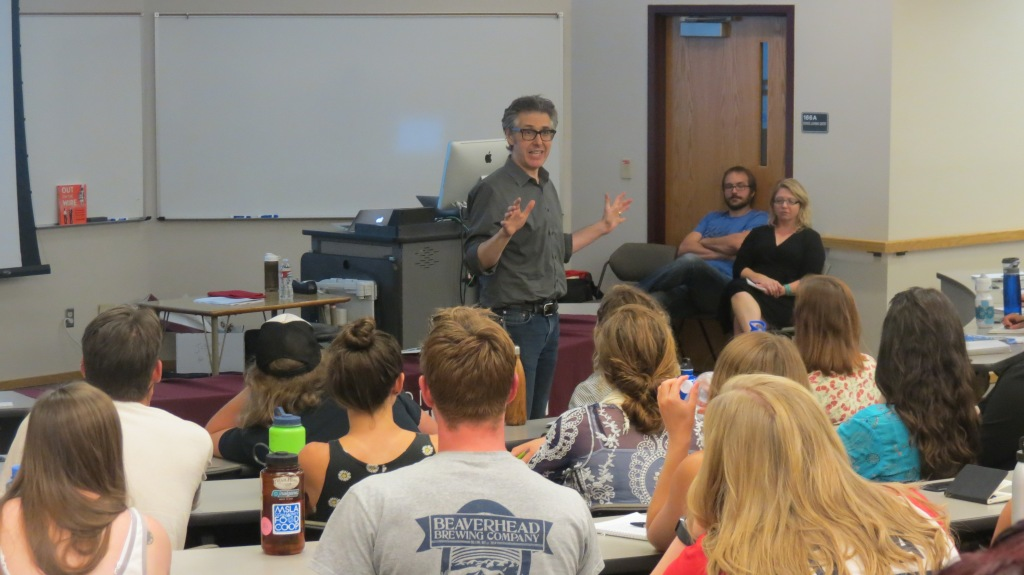 Ira Glass speaks to students and professors from the UM J-School
