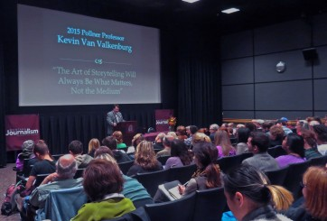 Kevin Van Valkenburg speaks to a crowded theater