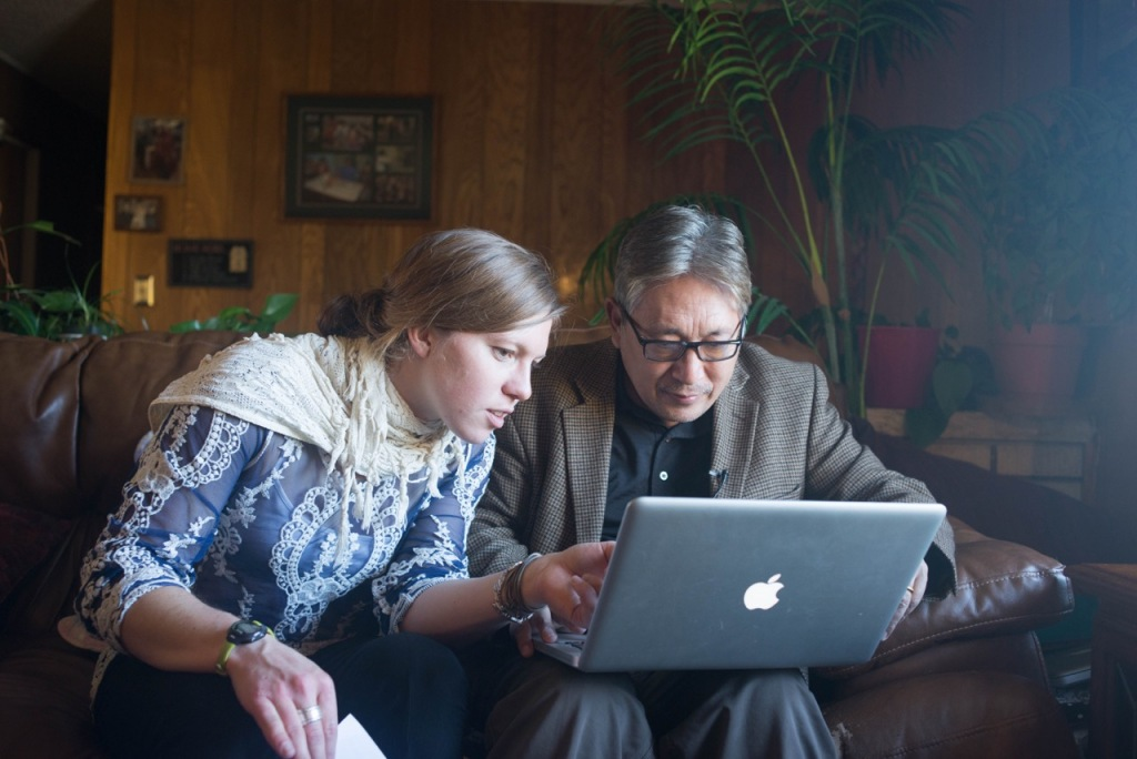 Graduate student Jayme Dittmar looks at old photos with Karma Tensum, Executive Director of the Tibetan Children's Education Foundation.