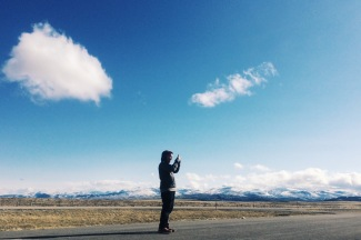 Kolby Kickingwoman stops to capture the view on the Blackfeet Indian Reservation, where he was reporting a story that placed 17th in the Hearst Journalism Awards.