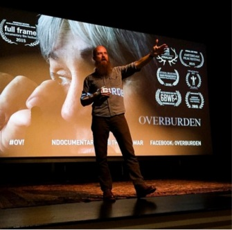 "Chad A. Stevens speaks to the audience a screening of ""Overburden"" in Boulder, Colorado."