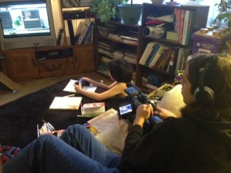 A student films the subjects of the documentary in the behind the scenes photo.
