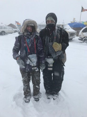 University of Montana School of Journalism student Tailyr Irvine, right, and UM alumni and Billings Gazette photojournalist Brontë Wittpenn 16' braved a blizzard to cover the reaction when the U.S. Army Corps of Engineers denied an easement needed for the pipeline to cross the Missouri River a half mile from the border of the Standing Rock Sioux reservation. The two photojournalists took two trips in November and December to cover the Standing Rock Sioux movement against the Dakota Access Pipeline.