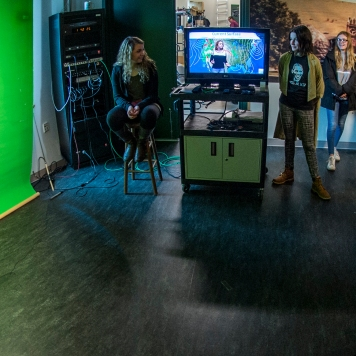 High school journalists get experience with the green screen in the studio at the the University of Montana School of Journalism. Photo by Todd Goodrich.