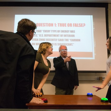 "Professor Dennis Swibold moderates his Fake News Game Show, in which students guess, ""Is it real or is it fake?"" with buzzers and everything. Photo by Jamie Drysdale."